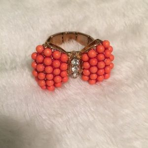 Orange bow ring